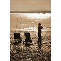 fishing beach sun light reflection silhouette solent england water father son