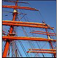 blue reddish mast rigging sail ship rope sky lines line angles masts high