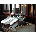 6/6 Preserved office at the Jackfield Tile Museum  A ledger, ink bottles, a paper spike and, fo...