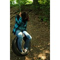forest tire swing portrait girl