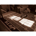 This picture was taken of a rug on my sons floor in his bedroom. The light reflected on the rug s...