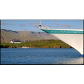 ship boat bow sea man blue iceland cruise travel houses water green