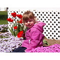 Emily with the spring flowers she loves