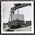 Railroad car granite block hoist men 1956