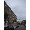 parked street local centre apartments houses bricks holland rotterdam car clouds