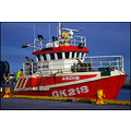 fishing boat harbour man harbor colour orange iceland grindavik