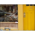 woman eating in chinatown toronto canada with yellow door