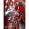 The Chandelier and Our Lady  A silver chandelier decorating a church in Cospicua, Malta with th...