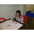 Carrom Player at a Club