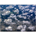 airplane clouds sky houses