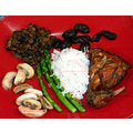 Rabbit braised in white wine with black garlic; green lentils; mushrooms, asparagus and rice.