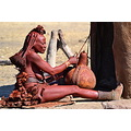 Himba woman making buttermilk