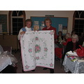 The winner of this years quilt.  (the lady on the left).  This is the first time one of our own m...