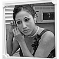 portrait candid bridesmaid primp jewelry wedding bw