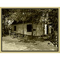 tavern house fence table door window tree bush grass sepia