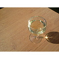 Summer sun shadow and a glass of wine