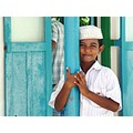boy front of mosque Friday prayers