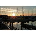 sunset marina boats sky clouds water